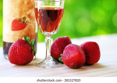 A Bottle and glass of  Raspberry Liqueur