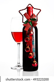 Bottle and glass of red wine christmas decoration on white background