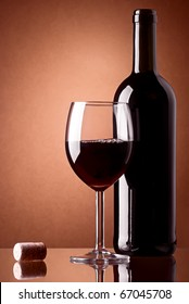 Bottle and a glass of red wine with cork