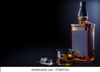 bottle and glass of whiskey with ice