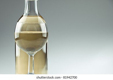 A bottle and a glass of white wine