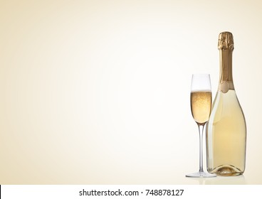 Bottle and glass of yellow champagne on yellow background
