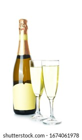 Bottle and glasses of tasty champagne on white background