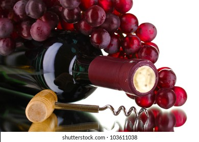 Bottle of great wine and corkscrew isolated on white