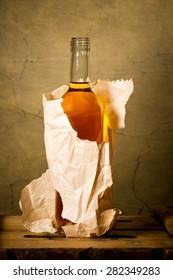 bottle of hard liqueur in the paper bag