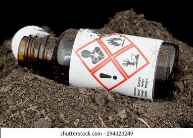 Bottle of hazardous substances thrown in the ground.