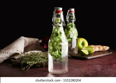 Bottle of healthy infused water on table