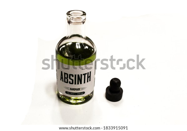 A bottle of homemade absinth, with cap open, strong alcoholic drink