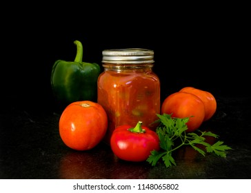 Bottle of homemade salsa with natural ingredients.