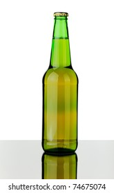 Bottle of lager beer from green glass, isolated on a white background.