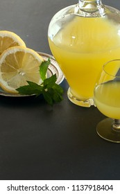 Bottle of limoncello and lemons of Sorrento decorated with mint