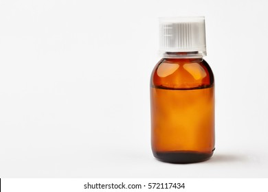 Bottle with liquid medicine. Transparent brown vial with lid. Stop your cold today.