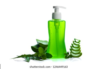 Bottle of liquid soap or cream or face wash dispensers with aloe vera, neem and basil leaf isolated on white background.