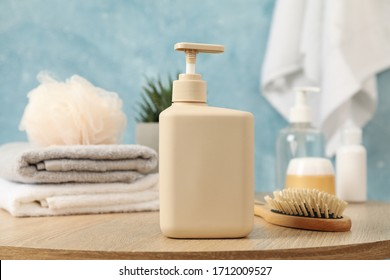 Bottle for liquid soap on wooden table. Personal hygiene concept
