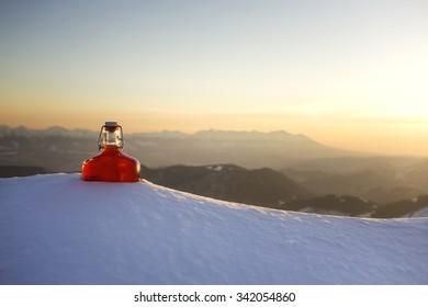 bottle of liquor zirbenschnaps in the snowy mountains