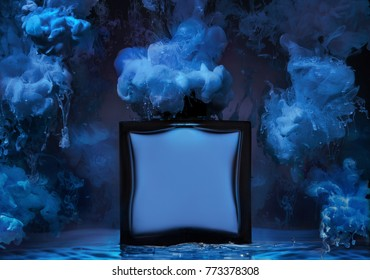 The  bottle of man's perfume stands in a water wave with clubs of blue paint around the bottle