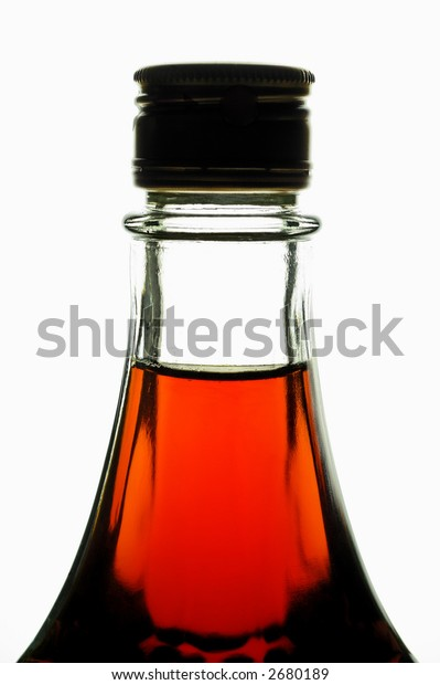 Bottle with maple syrup back lighted (vertical). Can be wine, liquor, etc.