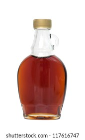 Bottle of maple syrup, isolated on white