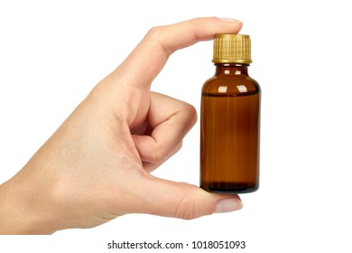 Bottle with medical elixir, syrup for colds, antipyretic suspension in hand. Isolated on white background. Health and medicine.