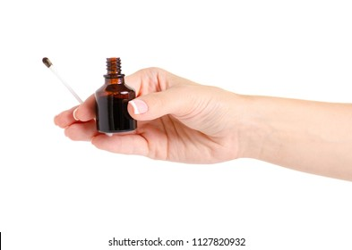 Bottle of medicine Iodine in the hand on a white background isolation