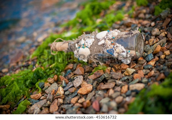 A bottle with a message on the seashore
