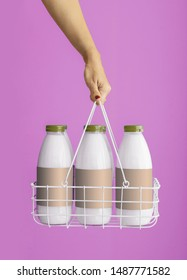 bottle of milks on the colored background