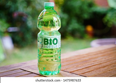 A bottle of mineral water in biodegradable and compostable material, circular economy.  Cuneo, Italy - August 2019