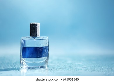 Bottle of modern male perfume on color background