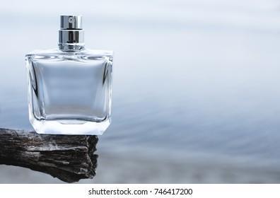 Bottle of modern perfume on blue background