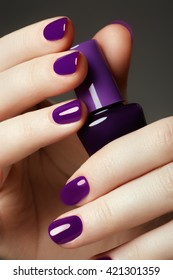 Bottle of nail polish. Beauty hands. Trendy stylish colorful nails, nailpolish. Great idea for the advertising of cosmetics. Beautiful manicuredl nails
