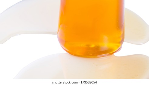 A bottle of natural honey over white background