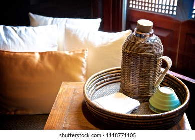 Bottle next to the Cushion