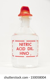 A bottle of nitric acid sits on a laboratory bench.