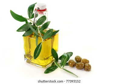 a bottle of olive oil and olive branch