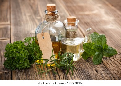 Bottle of olive oil with fresh herbs