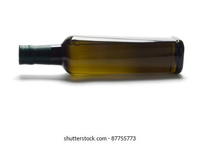 Bottle of olive oil lying on white background with copy space
