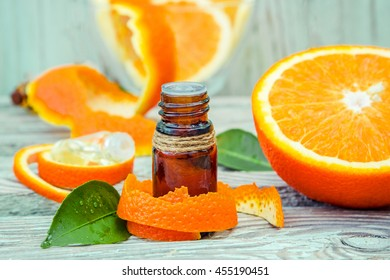 Bottle of orange essential oil for aromatherapy (Extract, tincture, decoction, juice) medicinal properties of orange.