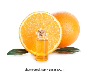 Bottle of orange essential oil on white background