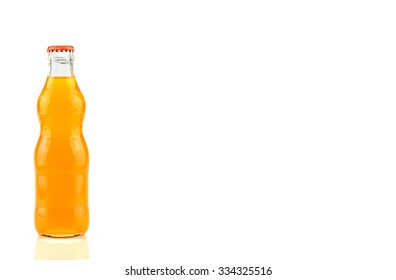 bottle of  Orange Fanta (coca cola) glass soda isolated on a white background