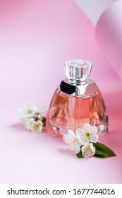Bottle of perfume with apricot blossom, cherry flowers