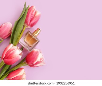 bottle perfume flower on colored background