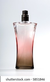Bottle of perfume isolated  on a grey background