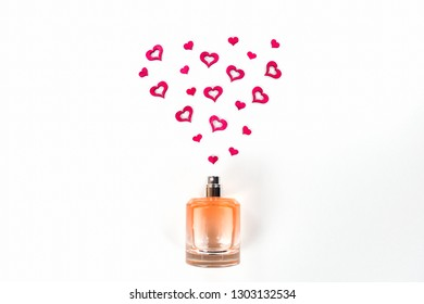 Bottle of perfume with red hearts flying out from it. Valentine's day, choosing fragrance, pheromones.