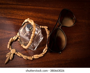 Bottle of perfume and sunglasses