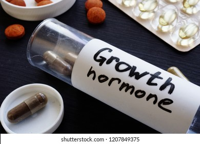 Bottle with pills and label Growth hormone.