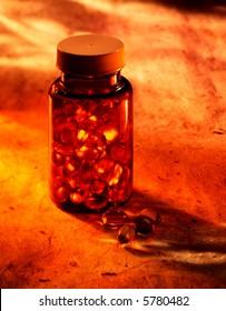 Bottle of pills in warm light