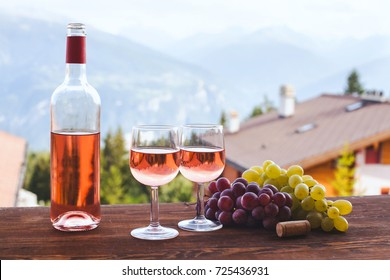 bottle of pink rose wine with two glasses, romantic dinner for couple