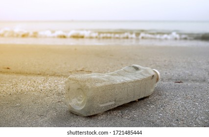 Bottle plastic on the beach ground show long life garbage concep