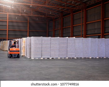 Bottle plastic on pallets are storage in the warehouse and factory, Material plastic storage on floor and racking.