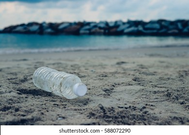 Bottle plastic on stone ground show long life garbage concept